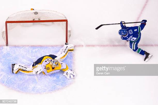 Brendan Leipsic of the Vancouver Canucks shoots the puck wide of Juuse Saros of the Nashville Predators during their NHL game at Rogers Arena on...