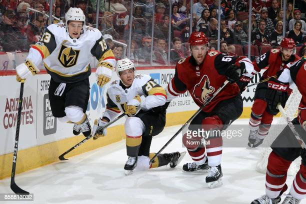Brendan Leipsic of the Vegas Golden Knights leaps over the stick of teammate Jonathan Marchessault as the puck is cleared away from Jason Demers of...