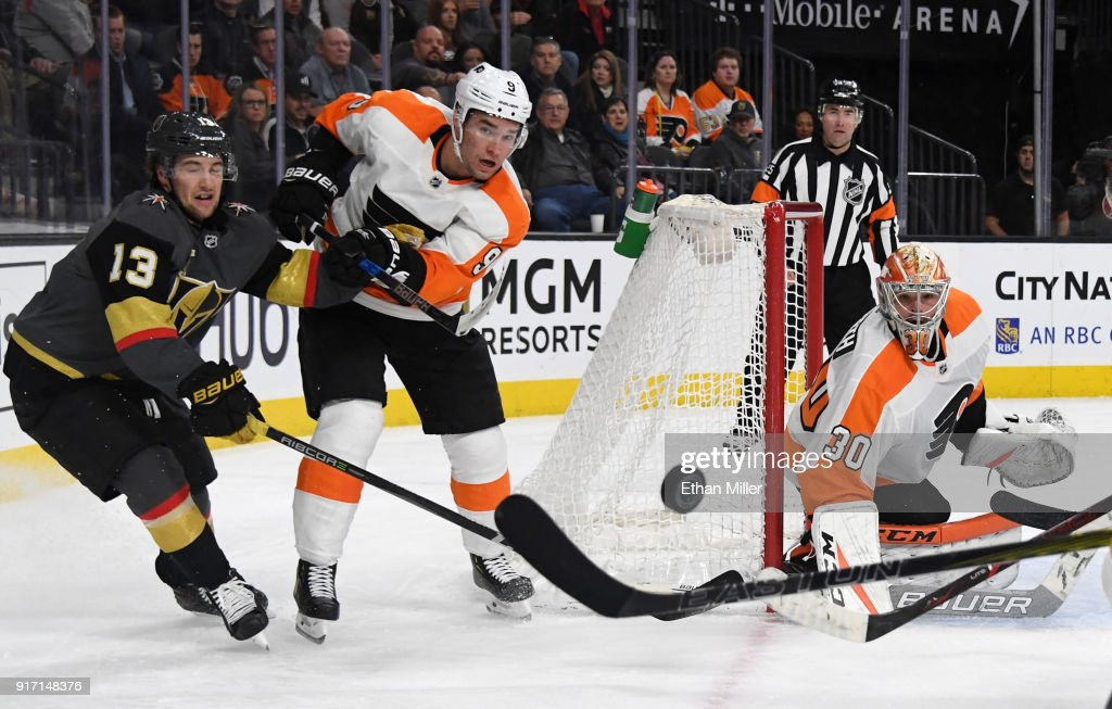 Brendan Leipsic #13 of the Vegas Golden Knights looks on as Ivan Provorov #9 of the Philadelphia Flyers clears the puck away from the net after Michal Neuvirth #30 of the Flyers blocked a shot in the second period of their game at T-Mobile Arena on February 11, 2018 in Las Vegas, Nevada. The Flyers won 4-1.