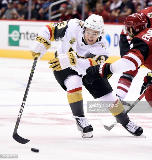 Brendan Leipsic of the Vegas Golden Knights reaches for the puck under pressure from Oliver EkmanLarsson of the Arizona Coyotes at Gila River Arena...