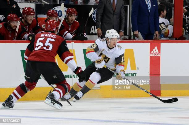 Brendan Leipsic of the Vegas Golden Knights skates with the puck as Jason Demers of the Arizona Coyotes defends during the first period at Gila River...