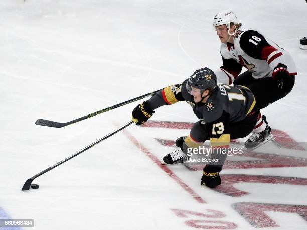 Brendan Leipsic of the Vegas Golden Knights skates with the puck under pressure from Christian Dvorak of the Arizona Coyotes at TMobile Arena on...