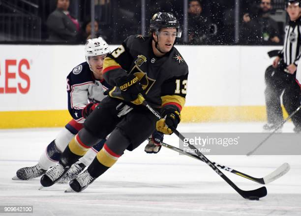Brendan Leipsic of the Vegas Golden Knights skates with the puck against Lukas Sedlak of the Columbus Blue Jackets in the first period of their game...