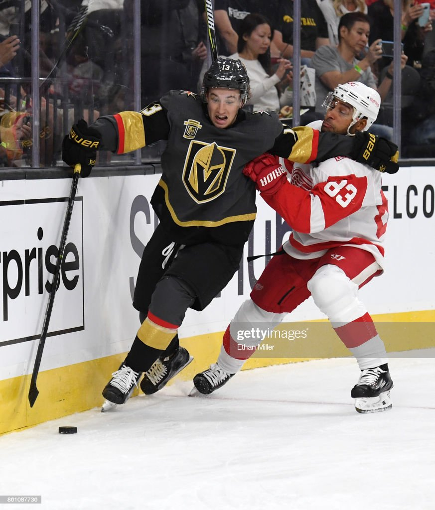 Brendan Leipsic #13 of the Vegas Golden Knights skates with the puck behind the net against Trevor Daley #83 of the Detroit Red Wings during their game at T-Mobile Arena on October 13, 2017 in Las Vegas, Nevada.