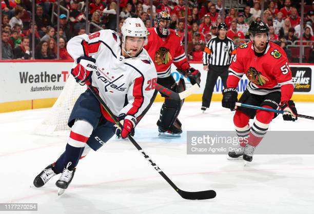 Brendan Leipsic of the Washington Capitals and Erik Gustafsson of the Chicago Blackhawks skate in the first period at the United Center on October 20...