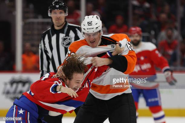 Brendan Leipsic of the Washington Capitals and Nicolas AubeKubel of the Philadelphia Flyers fight during the third period at Capital One Arena on...