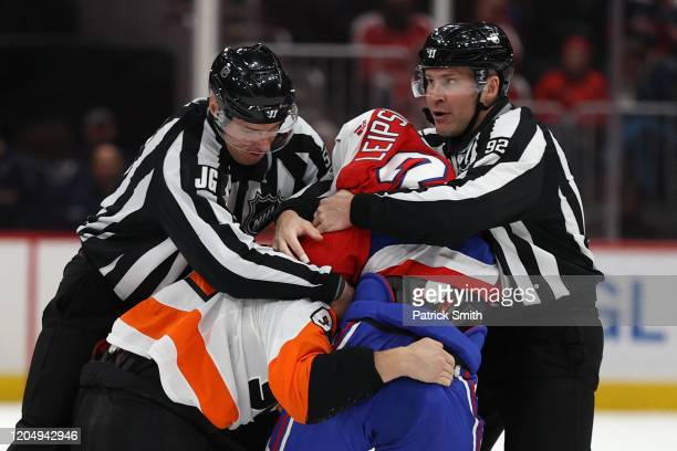Brendan Leipsic of the Washington Capitals and Nicolas Aube-Kubel of the Philadelphia Flyers fight during the third period at Capital One Arena on...