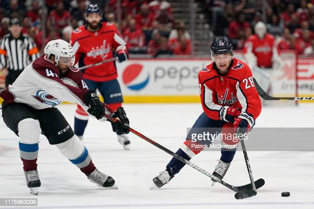 Brendan Leipsic of the Washington Capitals and Pierre-Edouard Bellemare of the Colorado Avalanche battle for the puck in the first period at Capital...