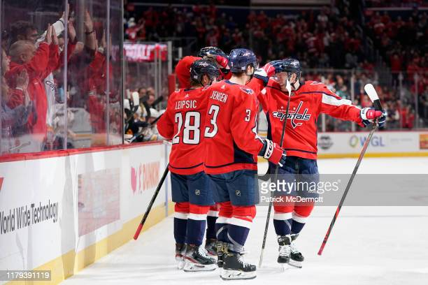 Brendan Leipsic of the Washington Capitals celebrates with his teammates after scoring a goal in the first period against the Buffalo Sabres at...