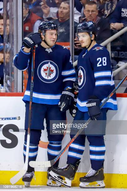Brendan Lemieux and Jack Roslovic of the Winnipeg Jets chat during a third period stoppage in play against the Columbus Blue Jackets at the Bell MTS...