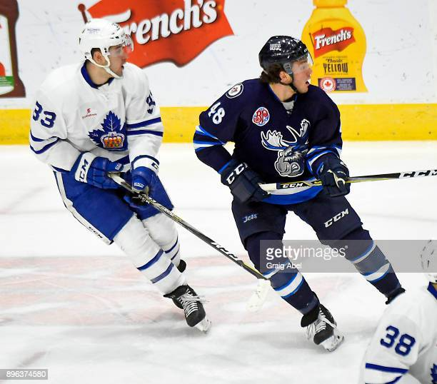 Brendan Lemieux of the Manitoba Moose turns up ice against Frederik Gauthier of the Toronto Marlies during AHL game action on December 17 2017 at...