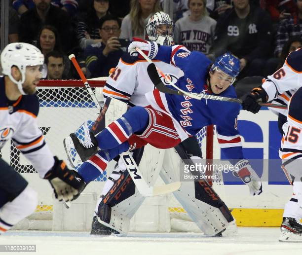 Brendan Lemieux of the New York Rangers is tripped up in front of Mike Smith of the Edmonton Oilers during the first period at Madison Square Garden...