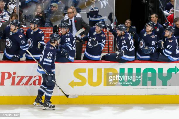Brendan Lemieux of the Winnipeg Jets celebrates his third period goal against the Pittsburgh Penguins with teammates at the bench at the Bell MTS...