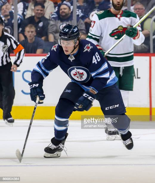 Brendan Lemieux of the Winnipeg Jets follows the play down the ice during first period action against the Minnesota Wild at the Bell MTS Place on...