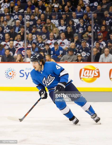 Brendan Lemieux of the Winnipeg Jets follows the play up the ice during third period action against the Pittsburgh Penguins at the Bell MTS Place on...