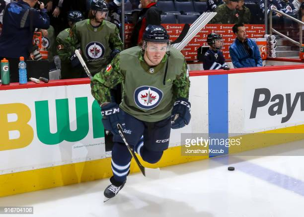 Brendan Lemieux of the Winnipeg Jets hits the ice for the pregame warm up sporting a Canadian Armed Forces themed jersey prior to NHL action against...