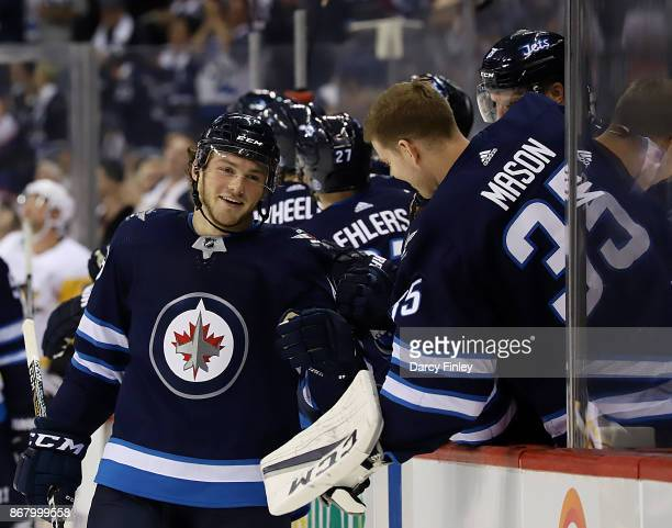Brendan Lemieux of the Winnipeg Jets is all smiles as he celebrates his first career NHL goal against the Pittsburgh Penguins with teammates at the...
