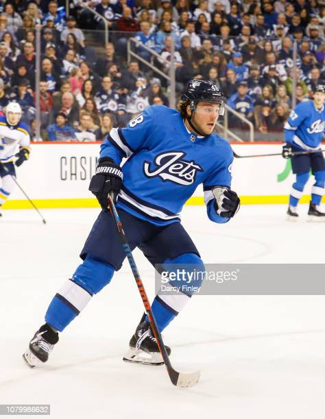 Brendan Lemieux of the Winnipeg Jets keeps an eye on the play during second period action against the St Louis Blues at the Bell MTS Place on...