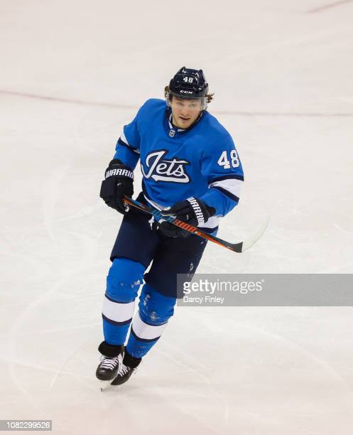 Brendan Lemieux of the Winnipeg Jets keeps an eye on the play during second period action against the Chicago Blackhawks at the Bell MTS Place on...