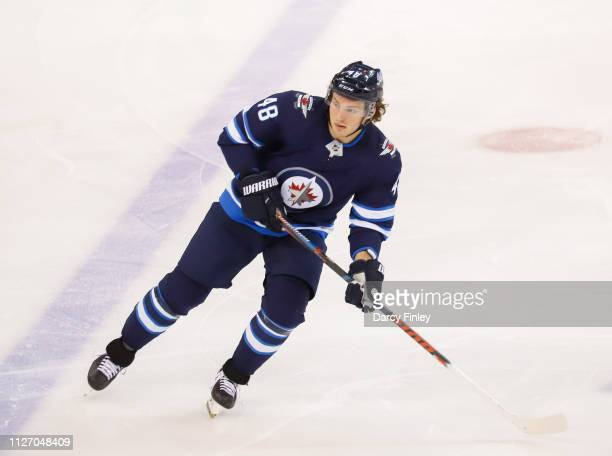 Brendan Lemieux of the Winnipeg Jets keeps an eye on the play during second period action against the Columbus Blue Jackets at the Bell MTS Place on...