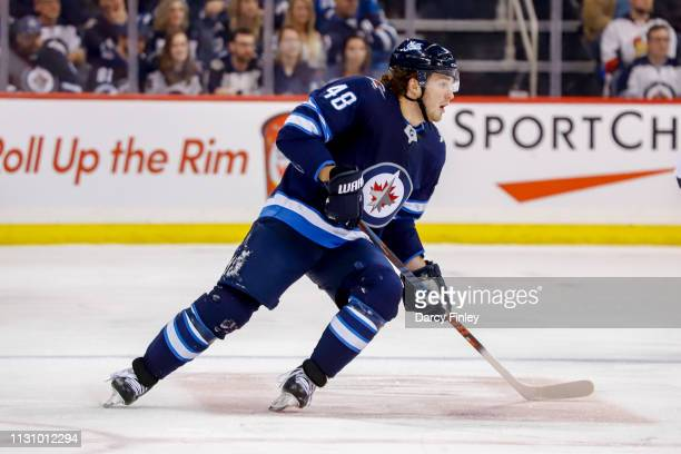 Brendan Lemieux of the Winnipeg Jets keeps an eye on the play during third period action against the Ottawa Senators at the Bell MTS Place on...