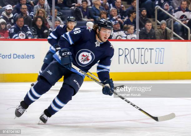Brendan Lemieux of the Winnipeg Jets keeps an eye on the play during first period action against the Arizona Coyotes at the Bell MTS Place on...