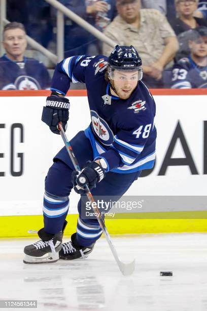 Brendan Lemieux of the Winnipeg Jets plays the puck down the ice during second period action against the New York Rangers at the Bell MTS Place on...