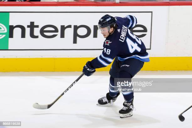 Brendan Lemieux of the Winnipeg Jets plays the puck down the ice during third period action against the Minnesota Wild at the Bell MTS Place on...