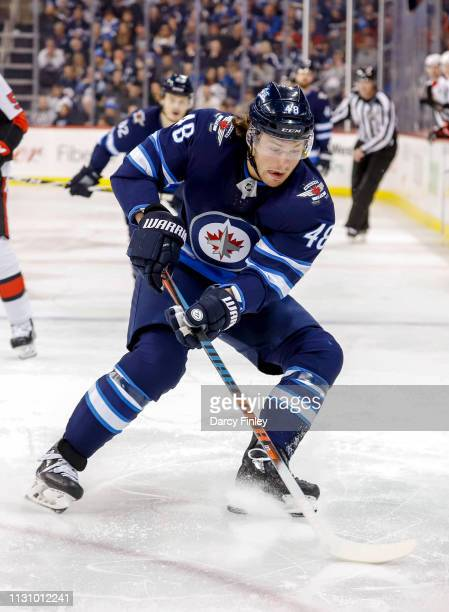 Brendan Lemieux of the Winnipeg Jets plays the puck during second period action against the Ottawa Senators at the Bell MTS Place on February 16 2019...