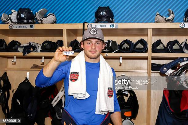Brendan Lemieux of the Winnipeg Jets poses with his game puck after scoring his first career NHL goal against the Pittsburgh Penguins at the Bell MTS...
