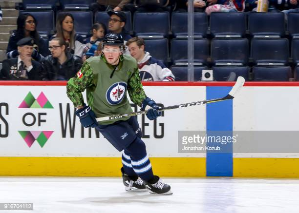Brendan Lemieux of the Winnipeg Jets takes part in the pregame warm up sporting a Canadian Armed Forces themed jersey prior to NHL action against the...