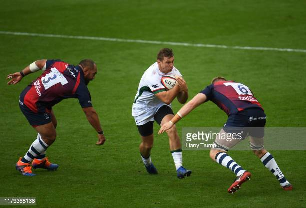 Brendan Macken of London Irish is tackled by Joe Joyce of Bristol Bears and John Afoa of Bristol Bears during the Premiership Rugby Cup Third Round...