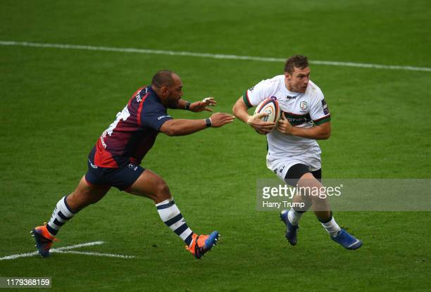 Brendan Macken of London Irish looks to break past John Afoa of Bristol Bears during the Premiership Rugby Cup Third Round match between Bristol...
