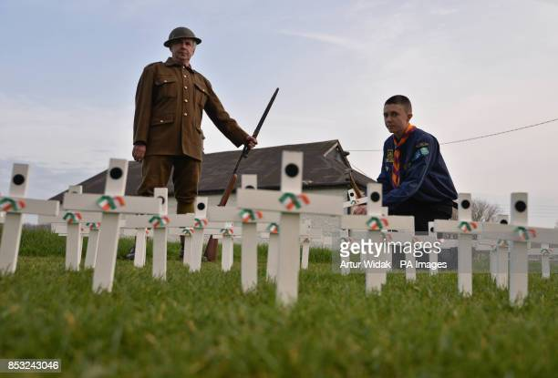Brendan MacQuaile wearing a WWI uniform and scout Aaron Crampton plant 50 white crosses as relatives of Irish war dead and campaigners seek to...