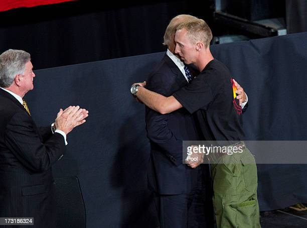 Brendan McDonough is greeted by US Vice President Joe Biden during a memorial service at Tim's Toyota Center during a memorial service honoring 19...