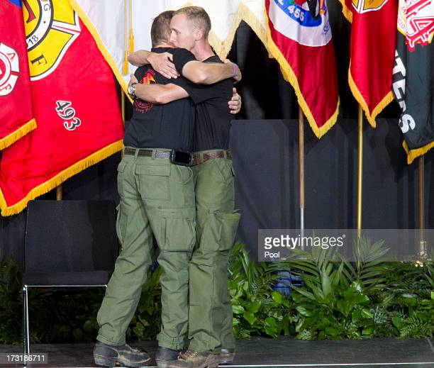 Brendan McDonough the sole surviving member of the Granite Mountain Hotshots crew hugs Darrell Willis Division Chief of the Prescott Fire Department...