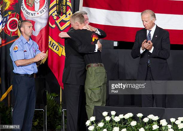 Brendan McDonough the sole surviving member of the Granite Mountain Hotshots crew hugs Harold A Schaitberger General President of the International...