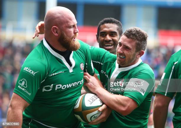 Brendan McKibbin of London Irish celebrate with try scorer Ben Franks during the Greene King IPA Championship Semi Final match between London Irish...