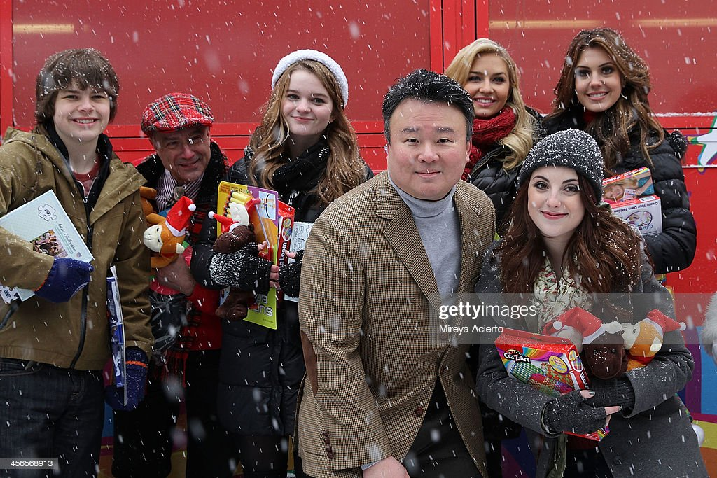 Brendan Meyer, Anthony Laciura, Kerris Dorsey, David W. Chien, Cassidy Wolf, Juliette Goglia and Erin Brady attend CitySightseeing New York 2013 holiday toy drive at PAL's Harlem Center on December 14, 2013 in New York City.