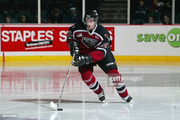 Brendan Mikkelson of the Vancouver Giants skates the puck out of the defensive zone against the Tri-City Americans during their WHL game on October...