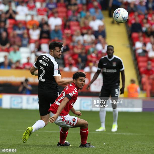 Brendan Moloney of Northampton Town looks to the ball with Jay Dasilva of Charlton Athletic during the Sky Bet League One match between Charlton...