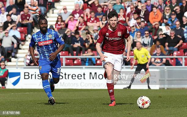 Brendan Moloney of Northampton Town moves forward with the ball away from Stanley Aborah of Notts County during the Sky Bet League Two match between...