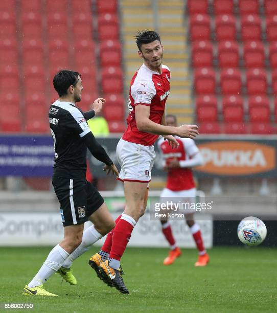 Brendan Moloneyof Northampton Town contests the ball with Kieffer Moore of Rotherham United during the Sky Bet League One match between Rotherham...