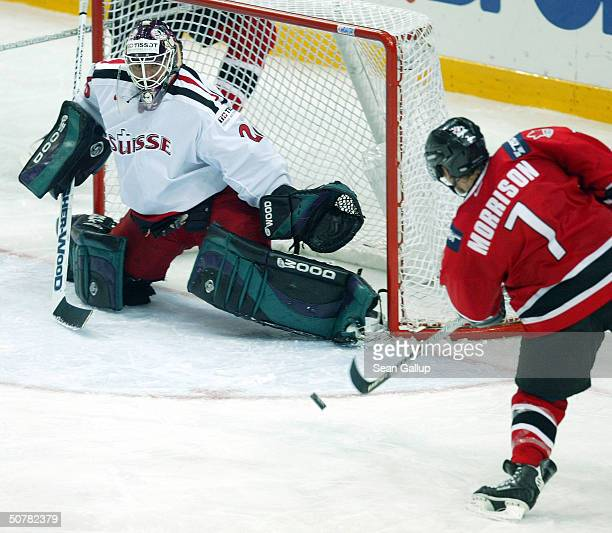 Brendan Morrison of Canada takes a shot on goal against goalie Martin Gerber of Switzerland in the teams' Group D qualifier match at the...