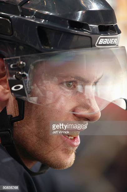 Brendan Morrison of the Vancouver Canucks looks on from the bench during the game against the Calgary Flames in the first round of the 2004 NHL...