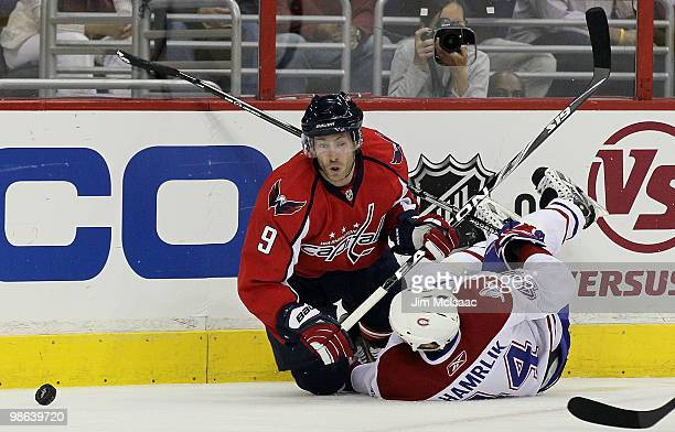 Brendan Morrison of the Washington Capitals battles fpr the puck against Roman Hamrlik of the Montreal Canadiens in Game Five of the Eastern...