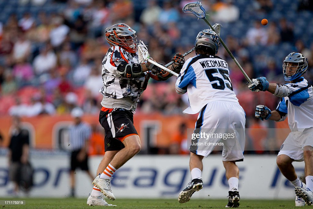Brendan Mundorf #2 of the Denver Outlaws shoots past Chad Wiedmaier #55 of the Ohio Machine during the first quarter at Sports Authority Field at Mile High on June 22, 2013 in Denver, Colorado.