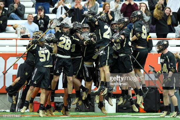 Brendan Nichtern of the Army Black Knights celebrates his goal with teammates on the sideline against the Syracuse Orange during the first half at...