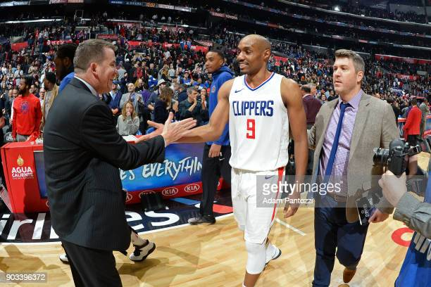 Brendan O'Connor and CJ Williams of the LA Clippers shake hands after the game against the Atlanta Hawks on January 8 2018 at STAPLES Center in Los...