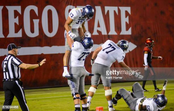 Brendan O'LearyOrange of Nevada celebrates with teammate Austin Corbett after scoring a touchdown in the first half against San Diego State at...